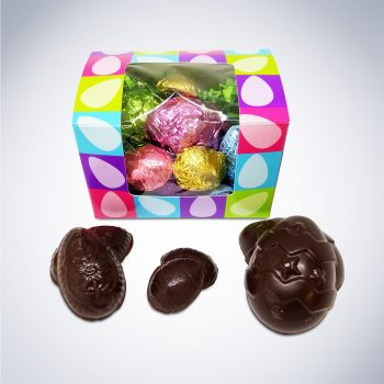 "Eggstatic Easter"" Window Box. Perfect for anyone with a nut allergy or dairy allergy! Made in a dedicated nut free facility and dairy free facility. An Easter-themed window box filled with an assortment of individually wrapped egg-shaped chocolates. Each box contains two large eggs, three medium eggs, and eight mini eggs, for 13 decorative eggs in total. Made with 6 oz. of semisweet, allergy friendly chocolate. You won't believe how good these beautiful eggs tastes! Our ""Eggtastic Easter"" Window Box will make a great Easter gift for someone you know who suffers from food allergies! But you certainly don't need to have a food allergy to enjoy it! Our semisweet chocolate is so good that many of our customers choose it simply because it's vegan and it tastes great! Certified Kosher Pareve. Please contact us directly with any questions about our Kosher certification or inspections. Net weight 6 oz. Allergy Free Info: No Peanuts, No Tree Nuts, No Dairy, No Eggs, No Soy, No Gluten, No Sesame, No Mustard, No Gelatin and No Corn Syrup! Non-GMO and Vegan! No artificial colors, flavoring or ingredients. INGREDIENTS : Organic Cane Sugar, Unsweetened Chocolate, Cocoa Butter [non dairy] Do you want to learn more about food allergies? Then check out the Safe Sweets – Resources Page! With new content being added each weekly, you'll have access to research, analysis, and thought-provoking insights. If you have any questions about this product, the ordering or shipping/pick-up process, or any other question, please e-mail us at info@safesweets.com. You can also find answers to many common questions at our FAQ page."
